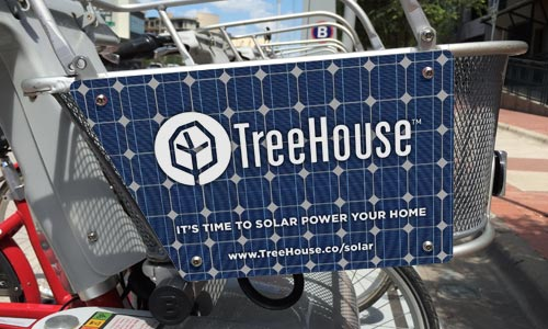 Bike basket advertisemtn with solar panel image on it